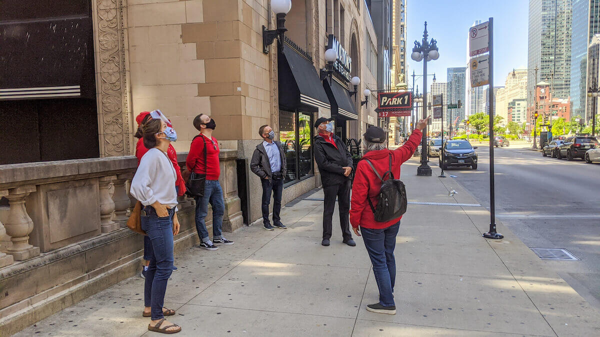 a group attends an architectural walking tour of chicago