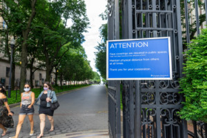 Columbia university with a sign explaining it's closed because of coronavirus, as have many architecture schools