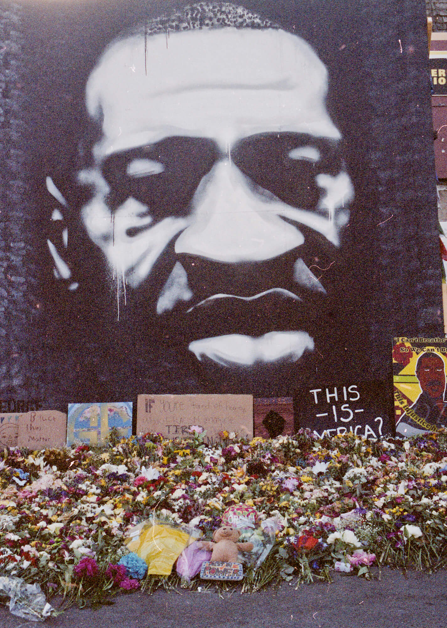 A black-and-white mural of George Floyd in Minneapolis