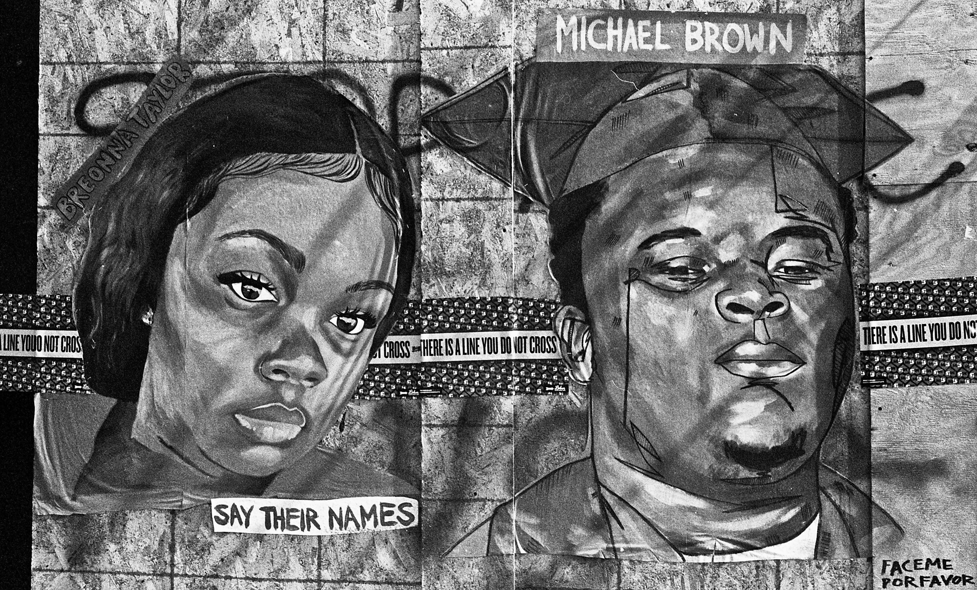 Black-and-white mural of two people killed by police