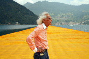 Photo of Christo standing on tensile yellow fabric