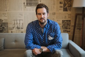 miguel mckelvey of wework on a couch