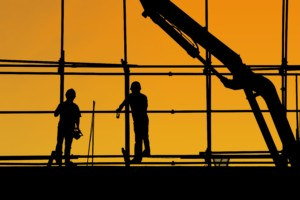 Nonresidential Construction workers at sunset