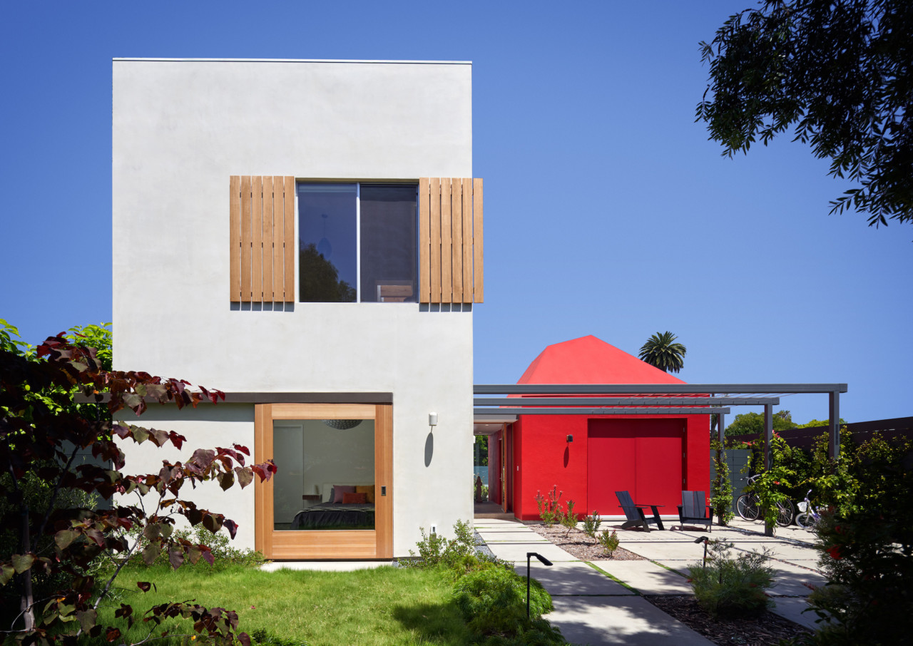 Boomerang house, a white blocky structure with a red addition