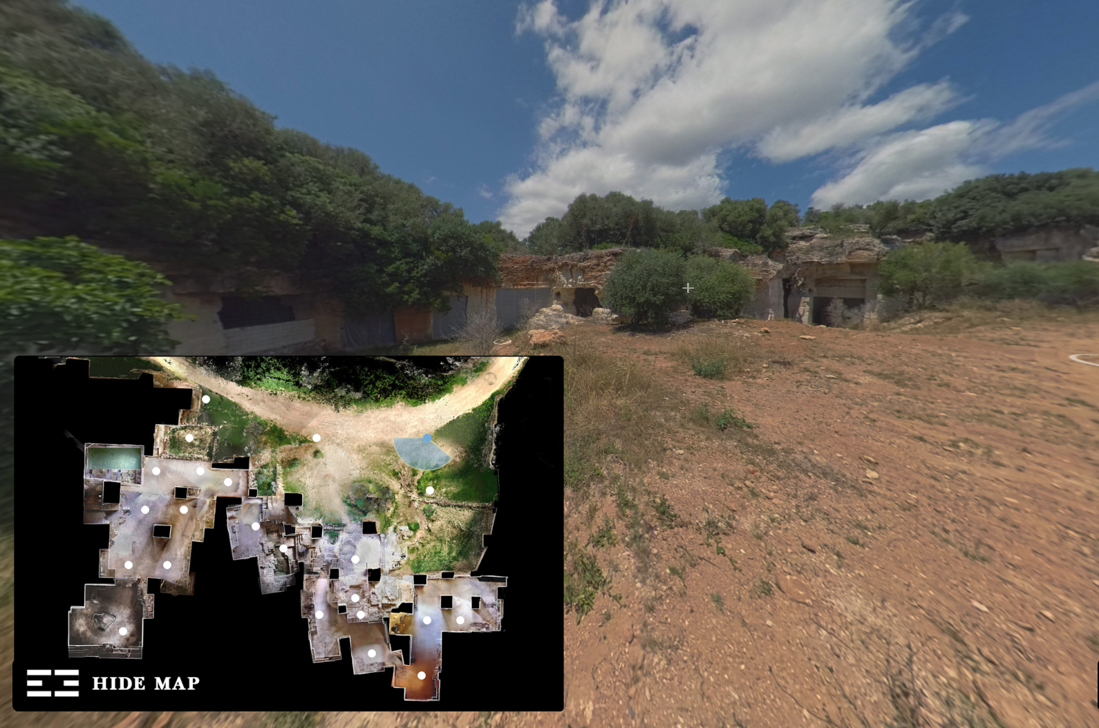 An overlay of a map over a google streetview photo of a quarry, from 'T' Space