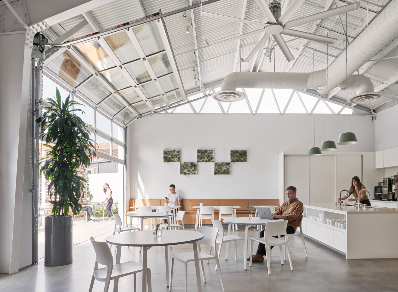 A white, double-height office space designed by Montalba