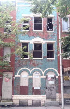 cab calloway house in baltimore, a decrepit red and blue row home
