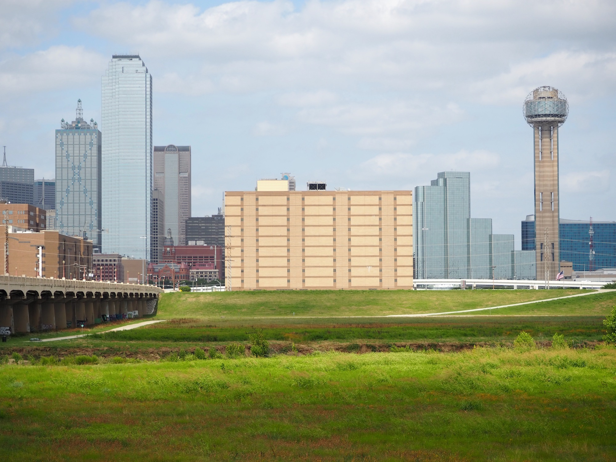 a jail building and the dallas skyline, which will be revamped by WEISS/MANFREDI