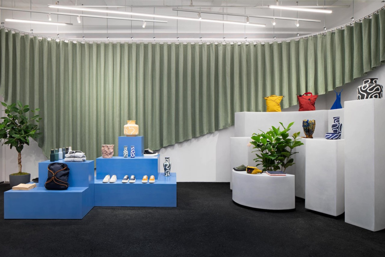 Interior of an ONS store with green rippled curtain by COLLECTIVE