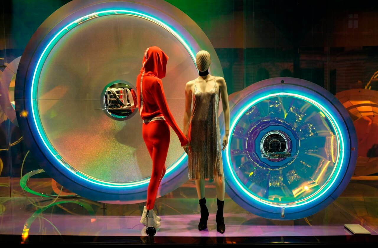Photo of mannequins in a multicolored storefront window