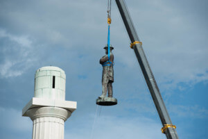 A confederate monument being removed