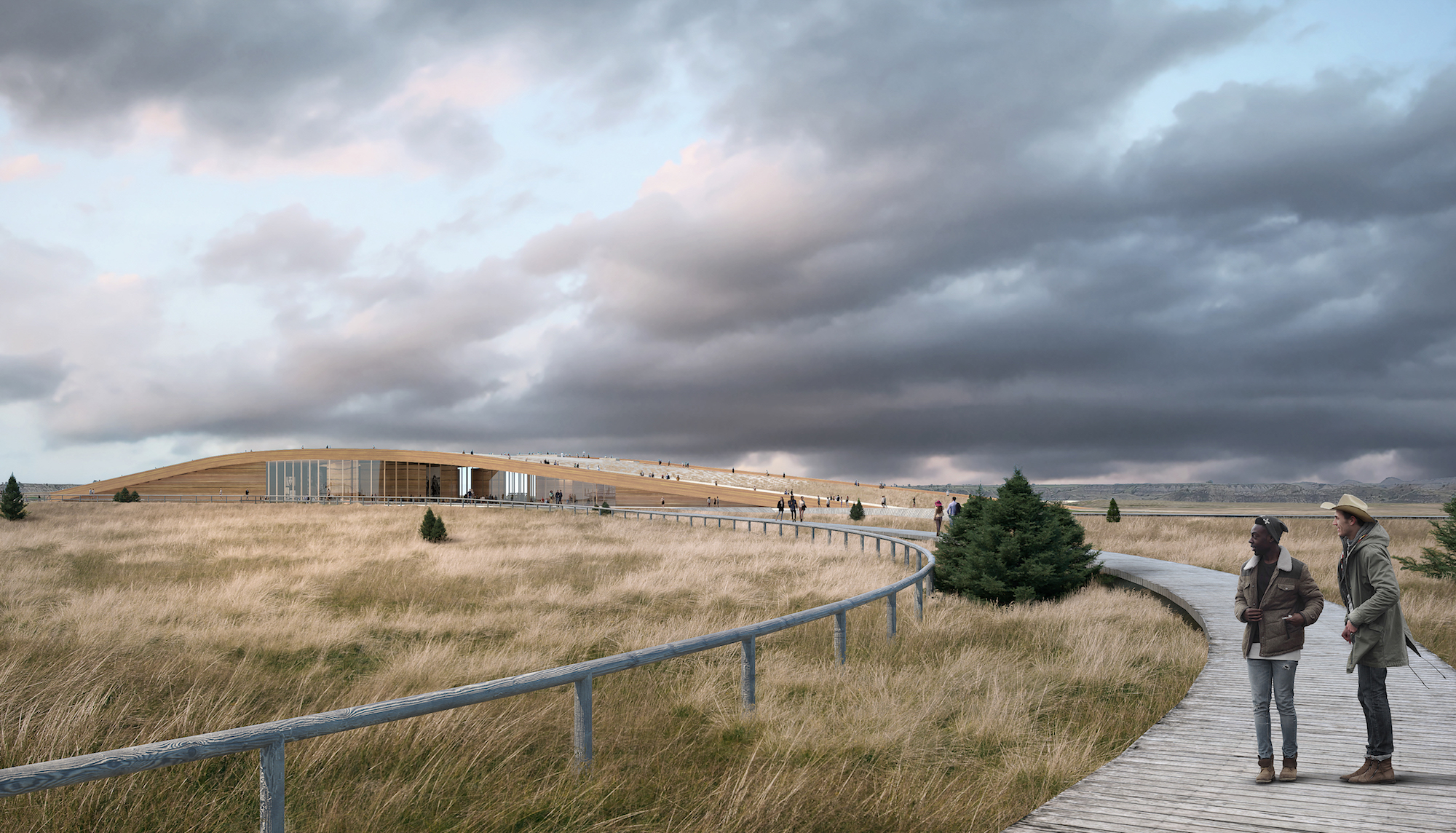 a boardwalk in the prairie showing the Theodore Roosevelt Presidential Library