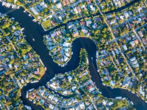 Aerial shot of fort lauderdale, showing a river winding between houses
