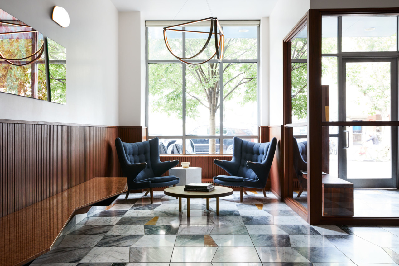 A lobby overhauled by GRT architects with zigzagging marble