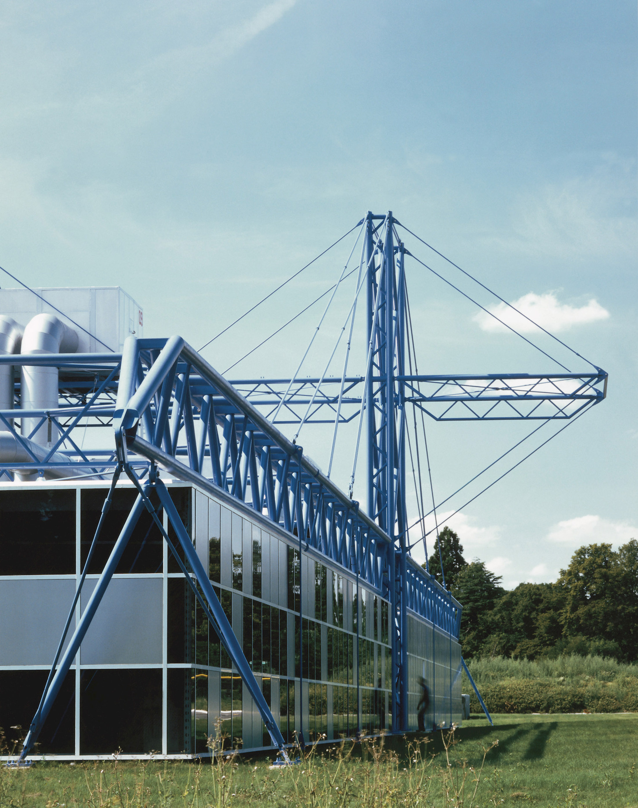 A richard rogers designed factory with blue steel exposed tower