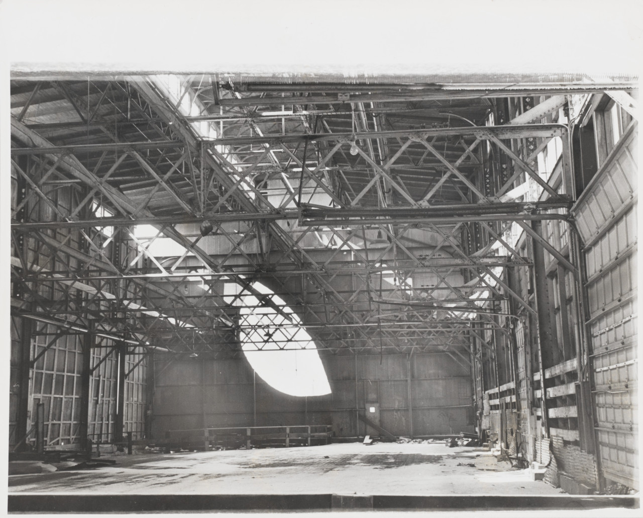 Photo of a warehouse interior with a sculptural cut in a wall, part of Around Day's End: Downtown New York