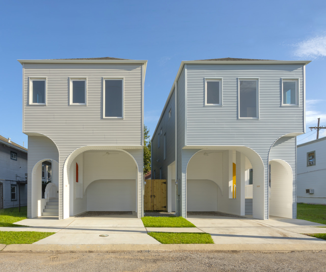 Two homes with colonnades out front, designed by office of jonathan tate