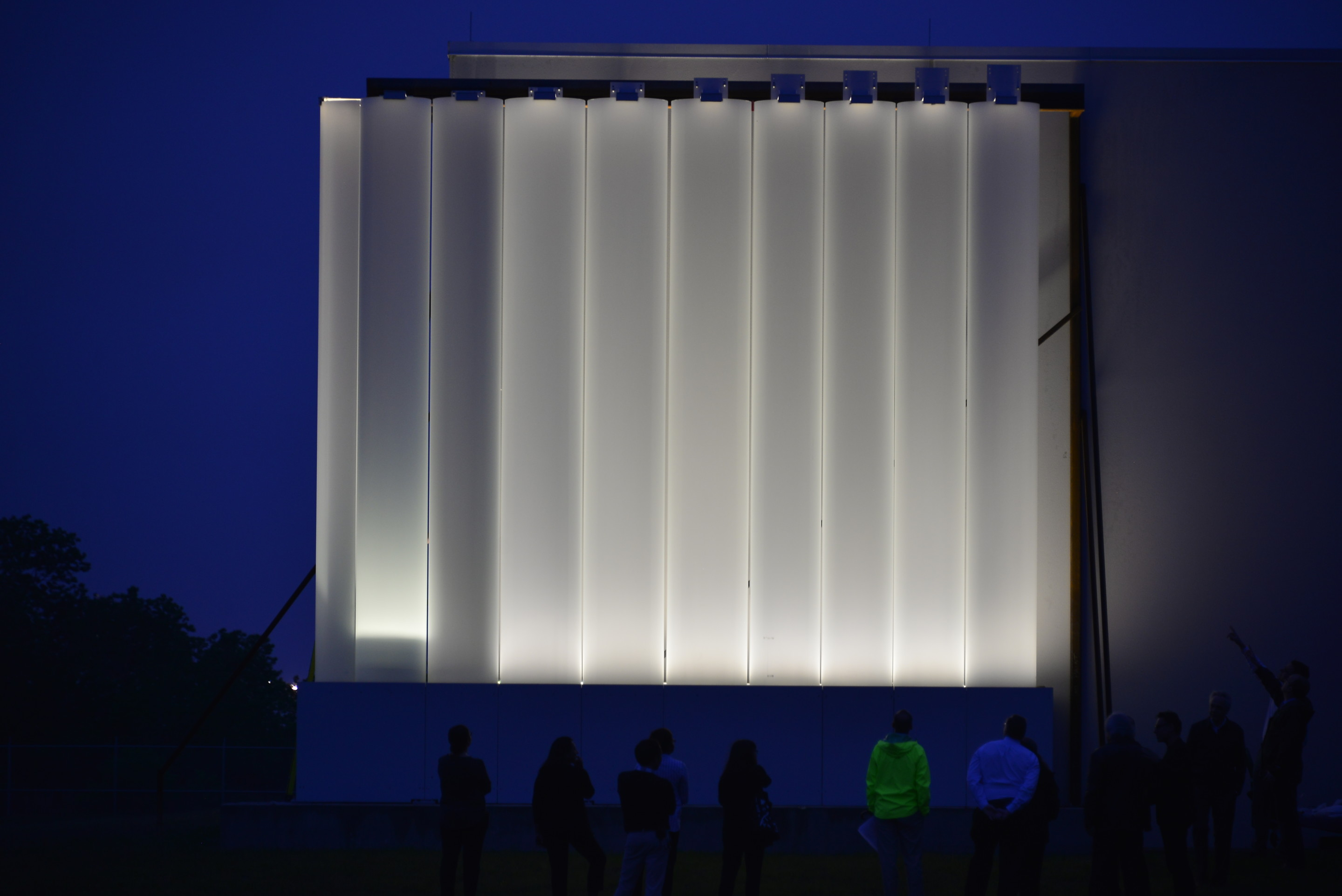 Image of facade mock up at night with lamp-like glow across the kinder building