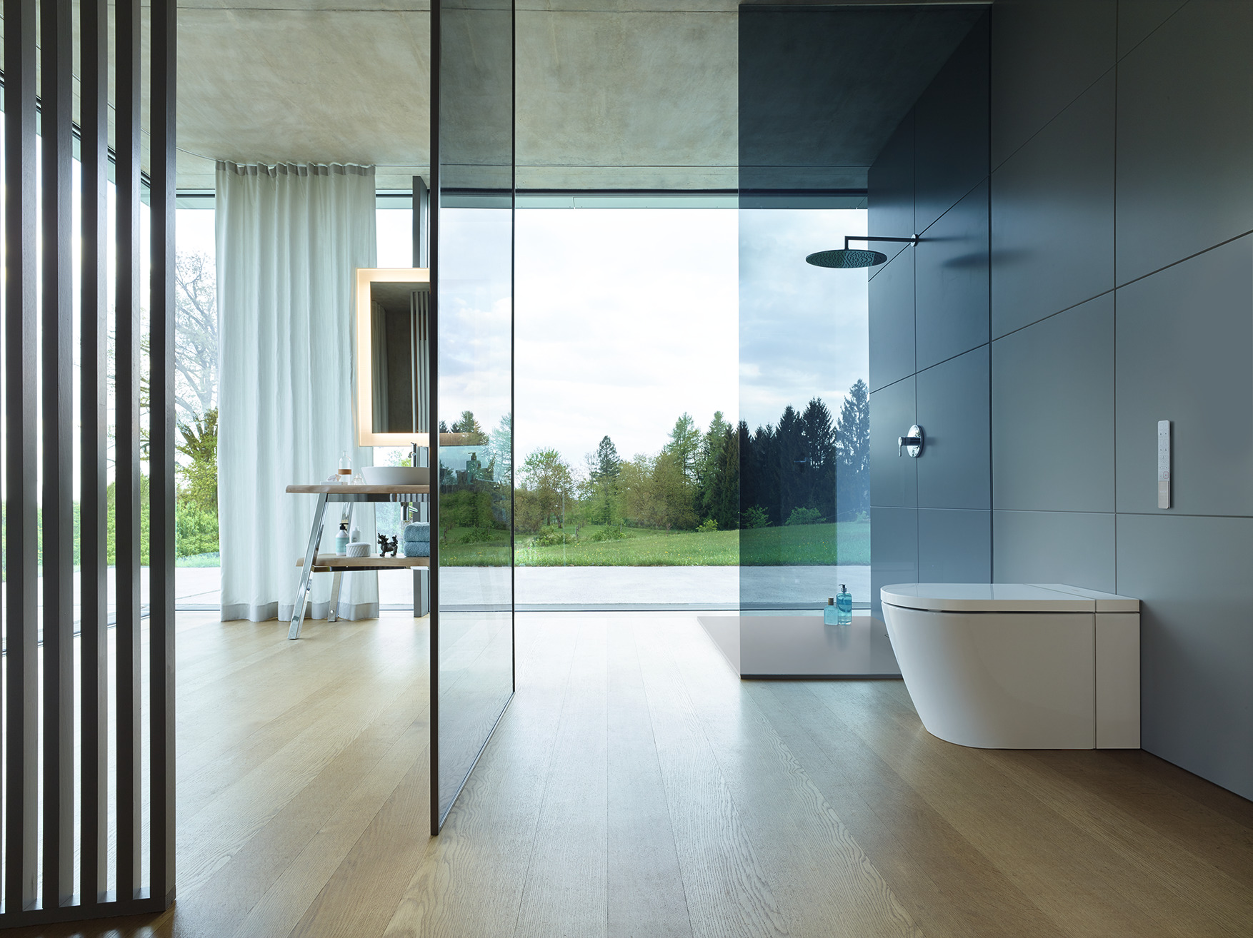 Clear glass partitions in front of a toilet, a 2020 best of products awards winner