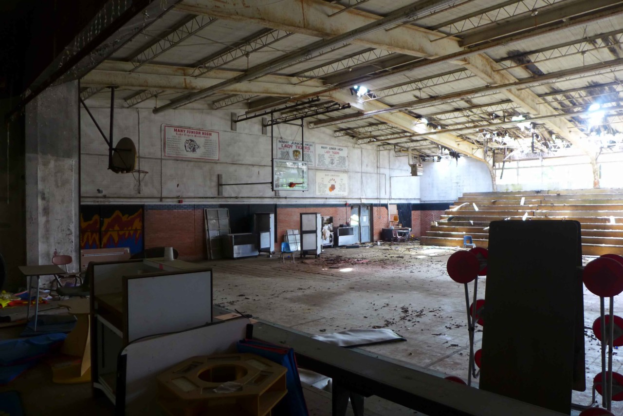 Interior of a crumbling segregation-era gym, the type being looked at by tulane researchers