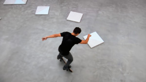 A man skateboarding on top of art