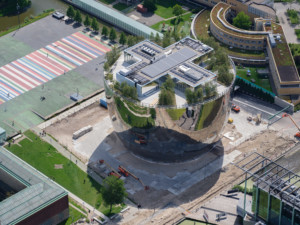 aerial view of a mirrored, bowl-shaped building in the netherlands