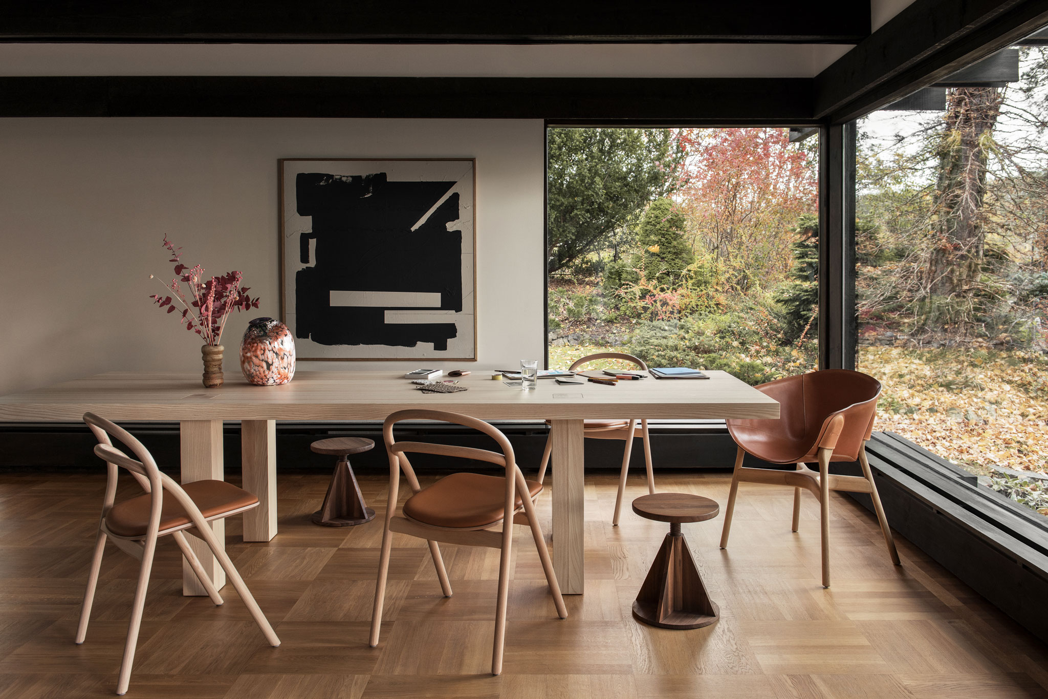 Wood chairs around a table, a 2020 best of products awards winner