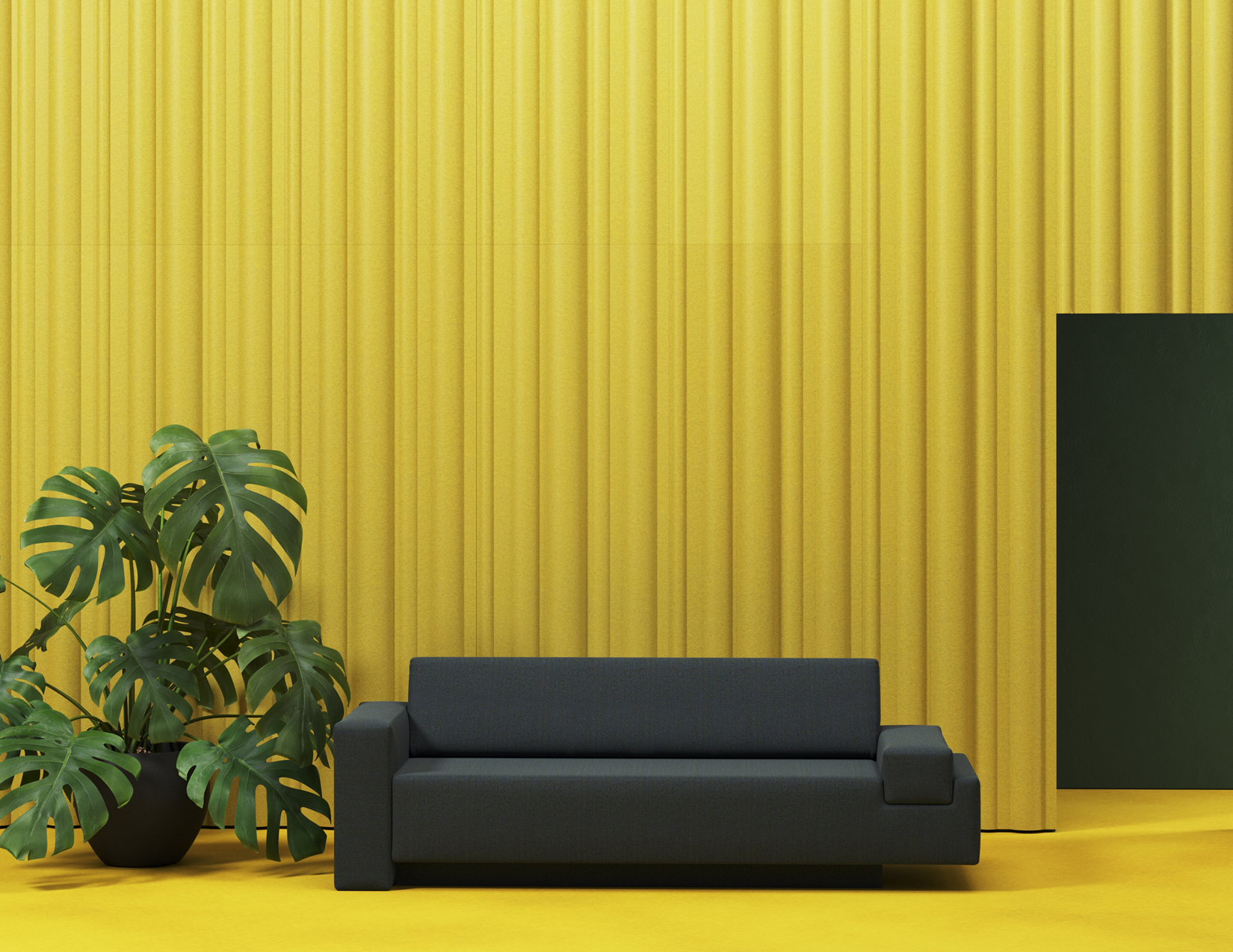 A yellow room with black couch