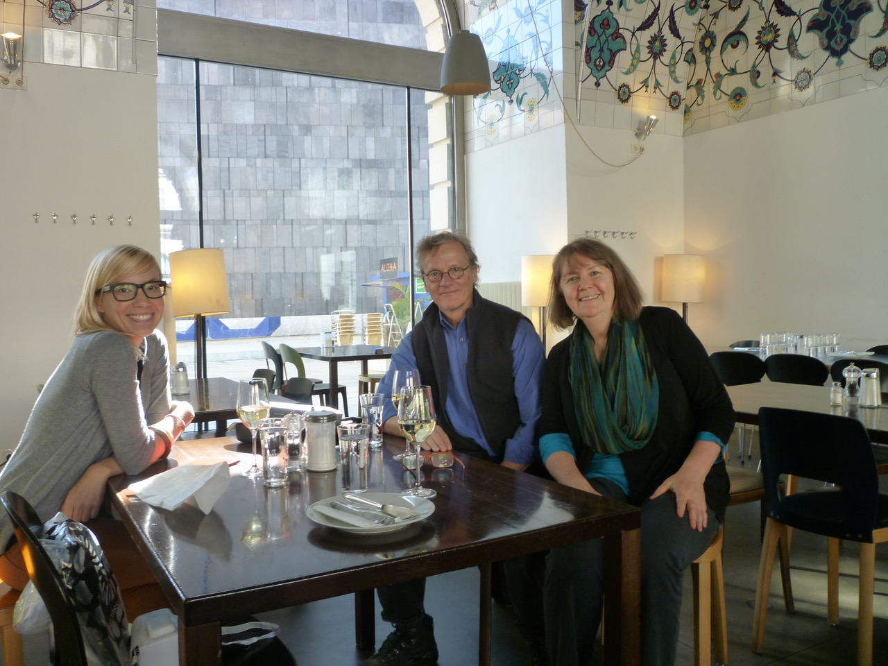 Three people around a table