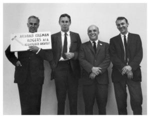 Black and white photo of four men, the far left being George Kostritsky