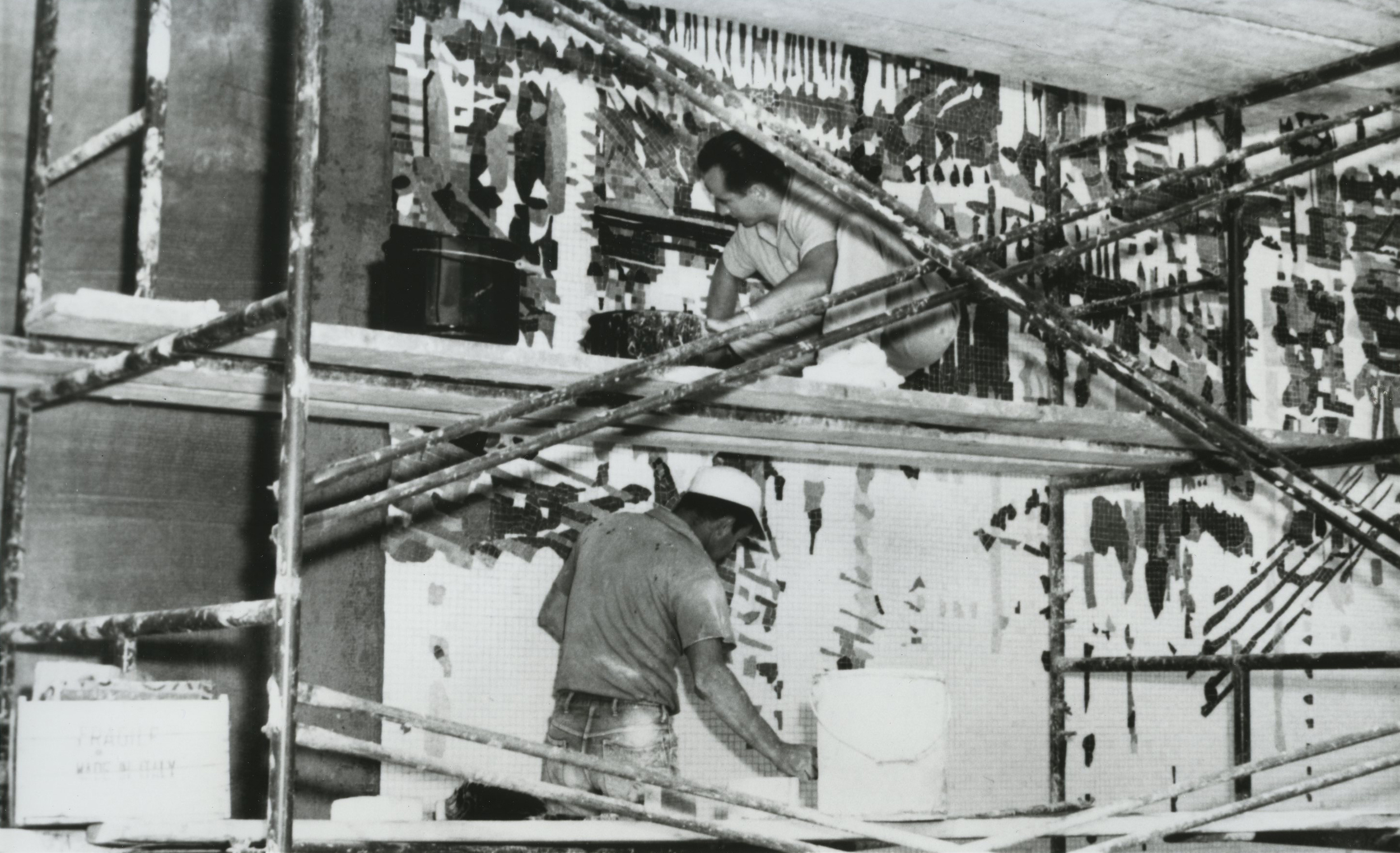 Vintage photos of work underway on a large mural