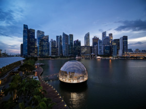 A floating apple store dome in front of the singapore skyline