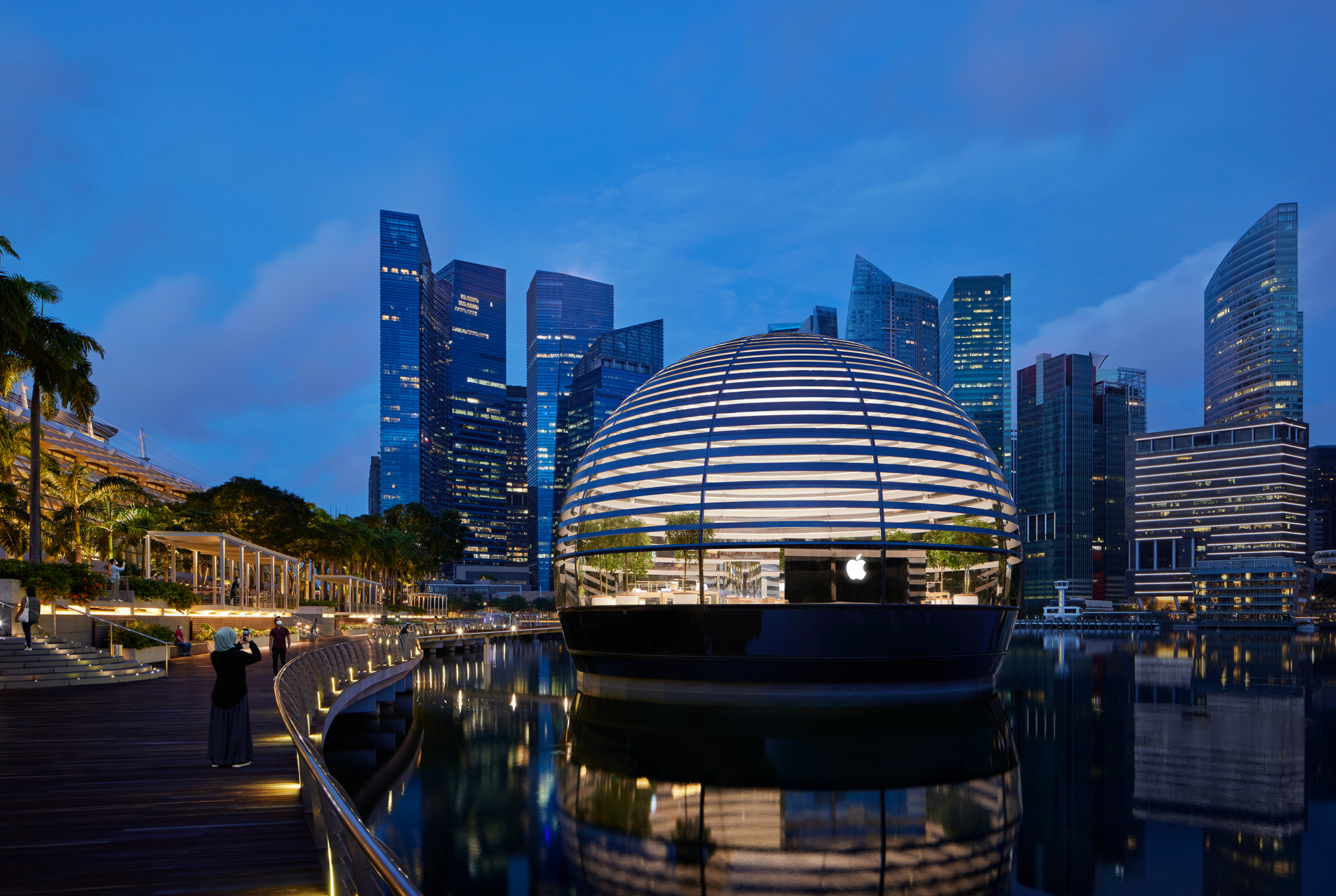 a floating spherical building in singapore pictured at night