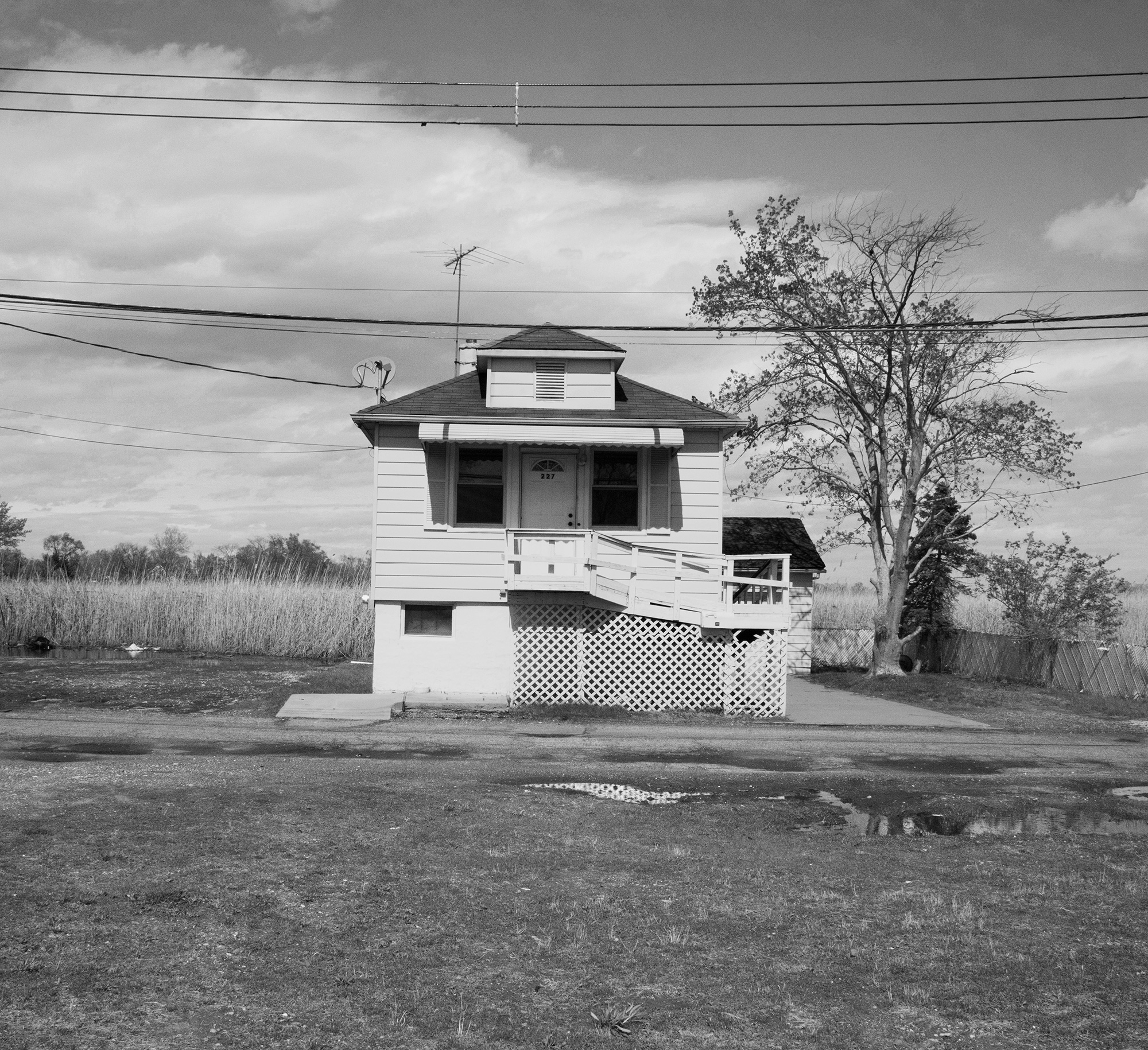 Black and white photo of a sea level ravaged house