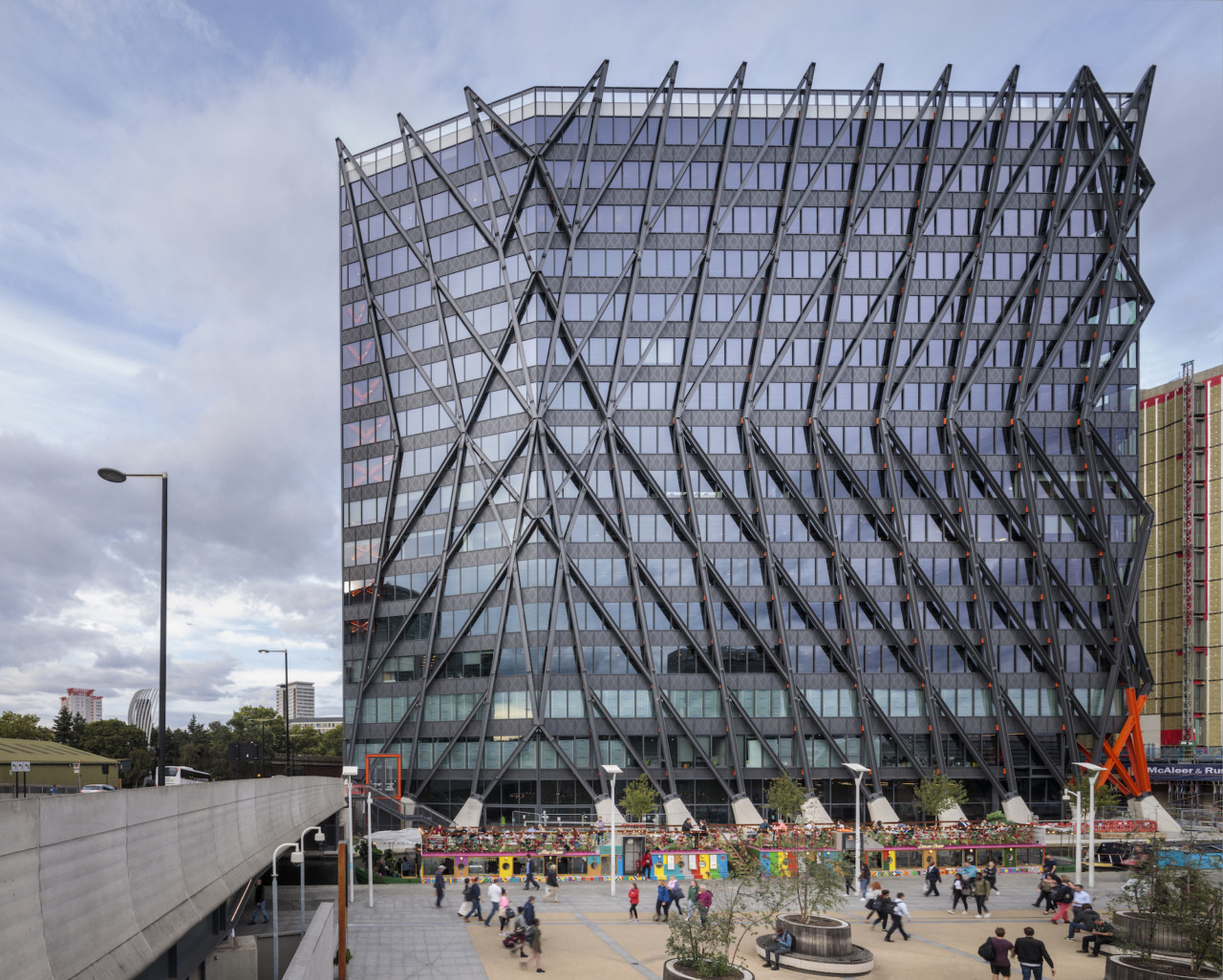 Exterior of the Brunel Building, a glass skyscraper covered in steel exoskeleton