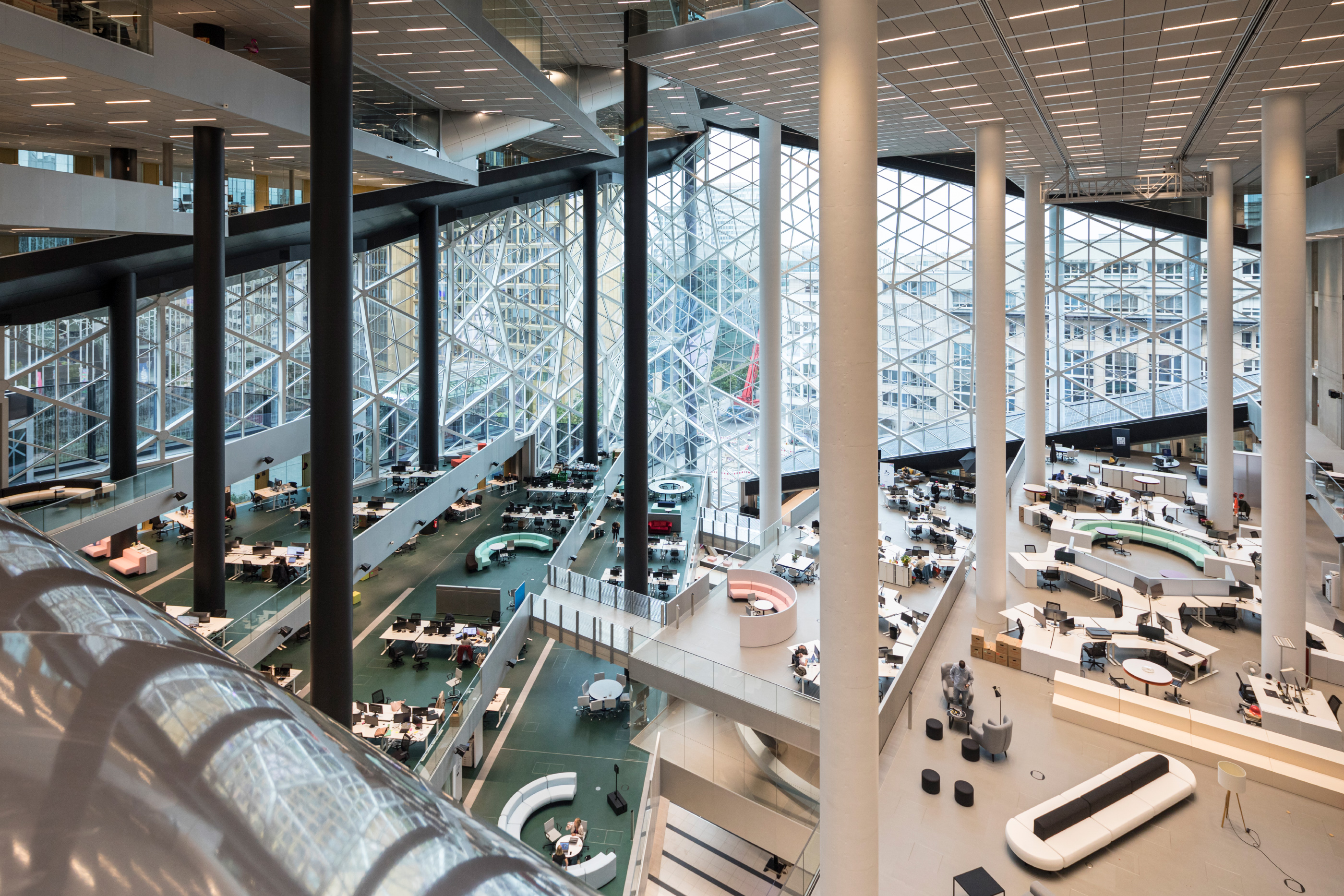 Interior of the new Axel Springer building looking out to a diamond shaped atrium