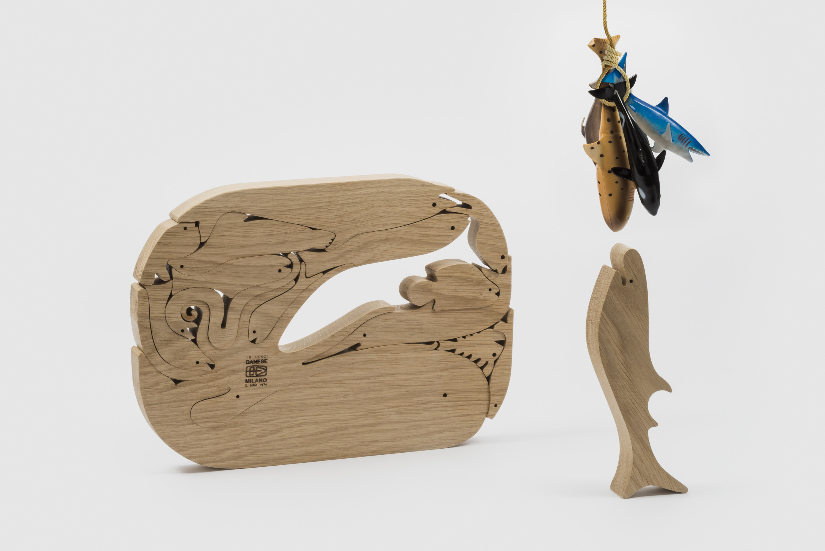 A wooden block puzzle designed by Enzo mari consisting of interlocking fish