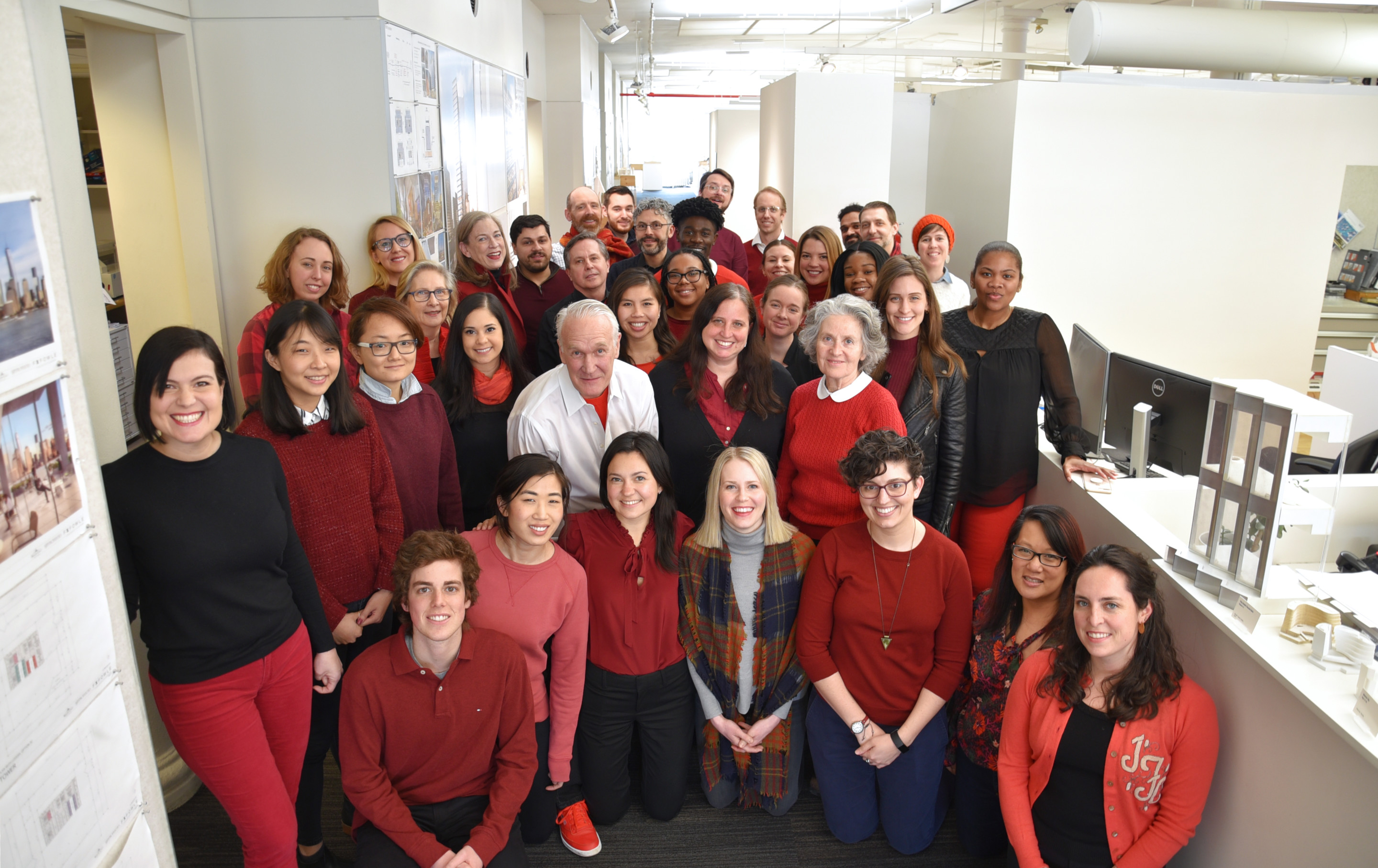 FXCollaborative employees in red gathered for womens day