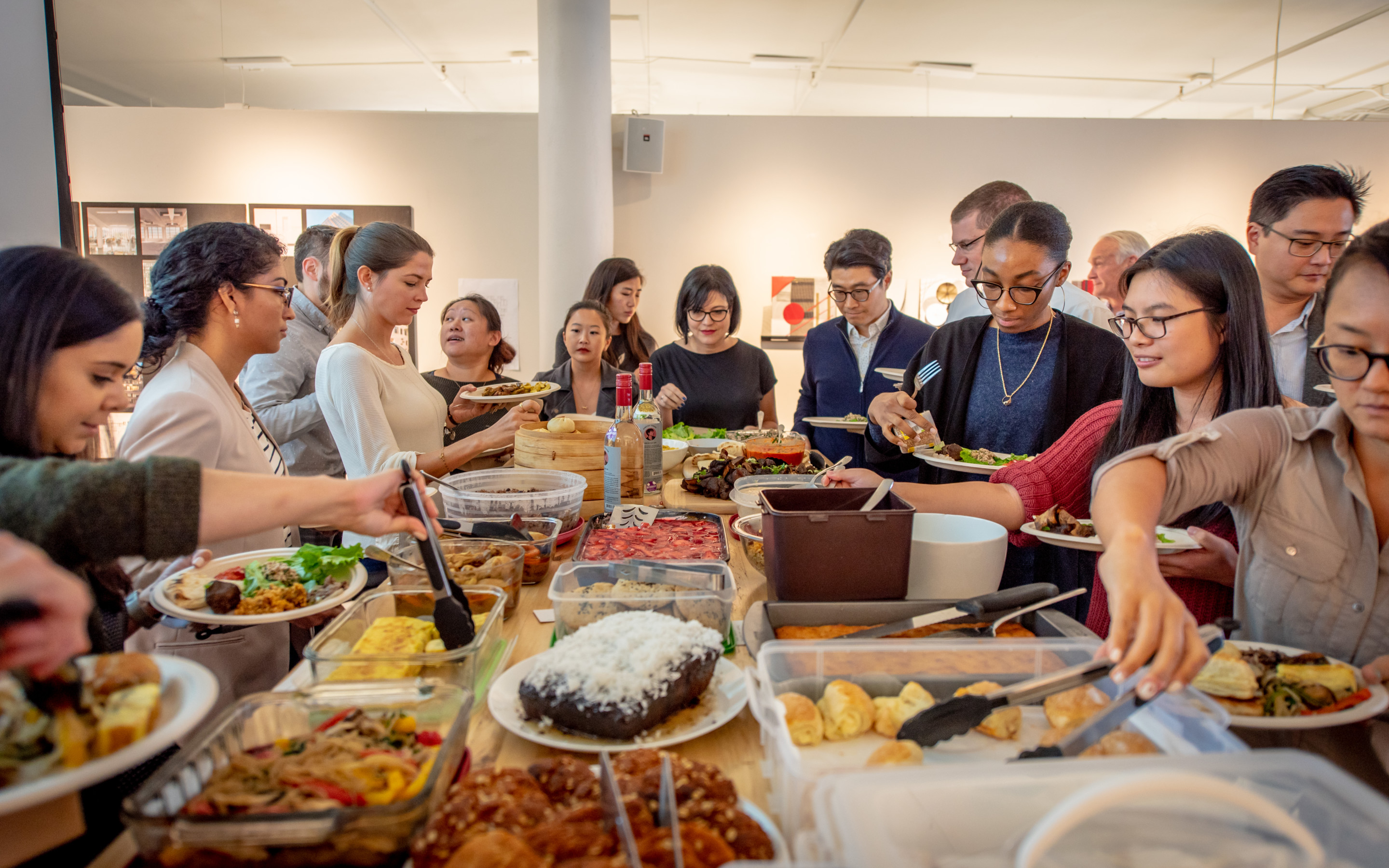 People gathered at a potluck