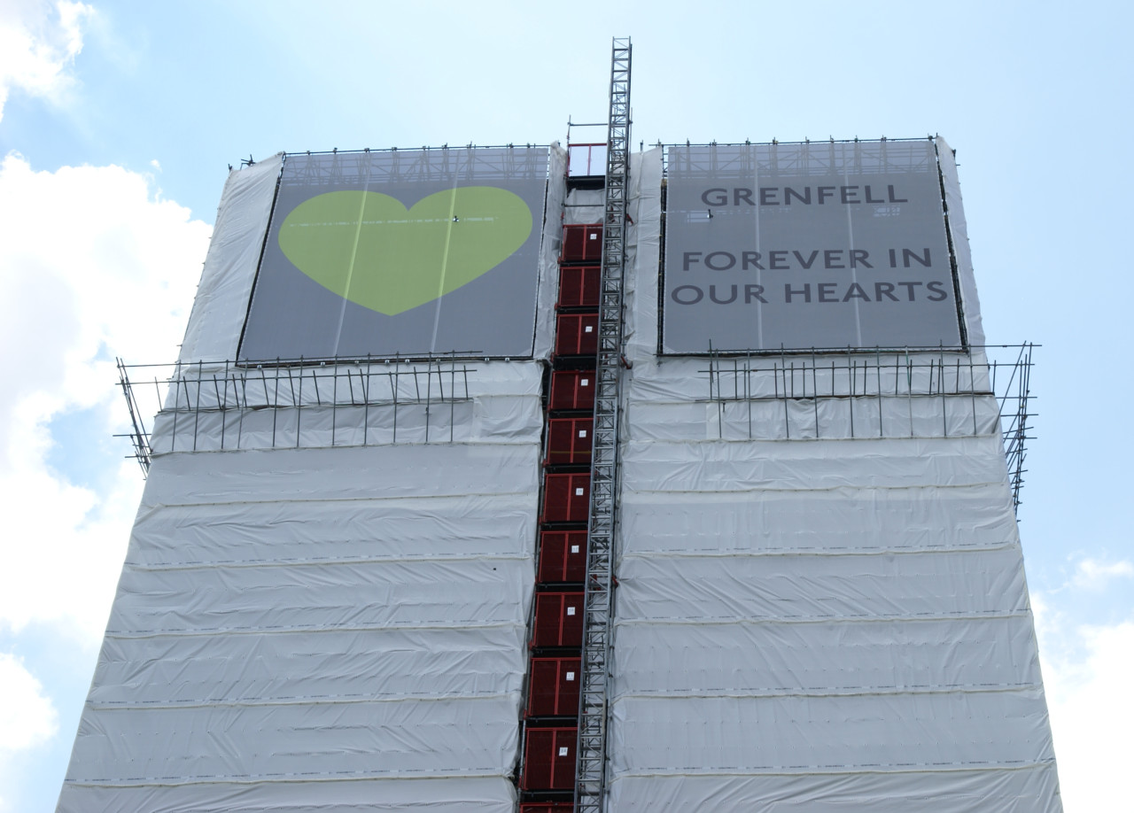 A wrapped tower with rememberances for grenfell victims