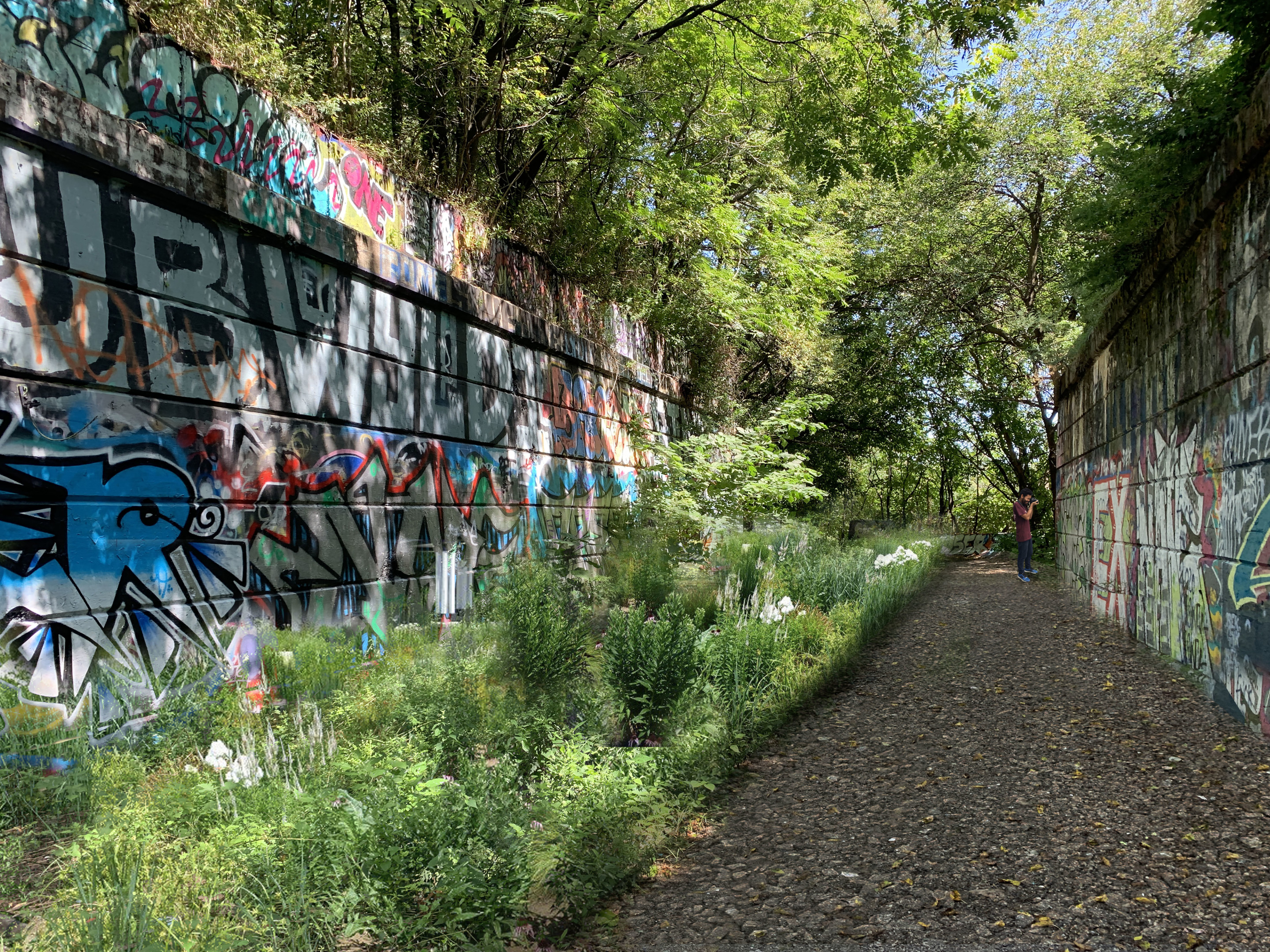 Rendering of a throughway with graffiti