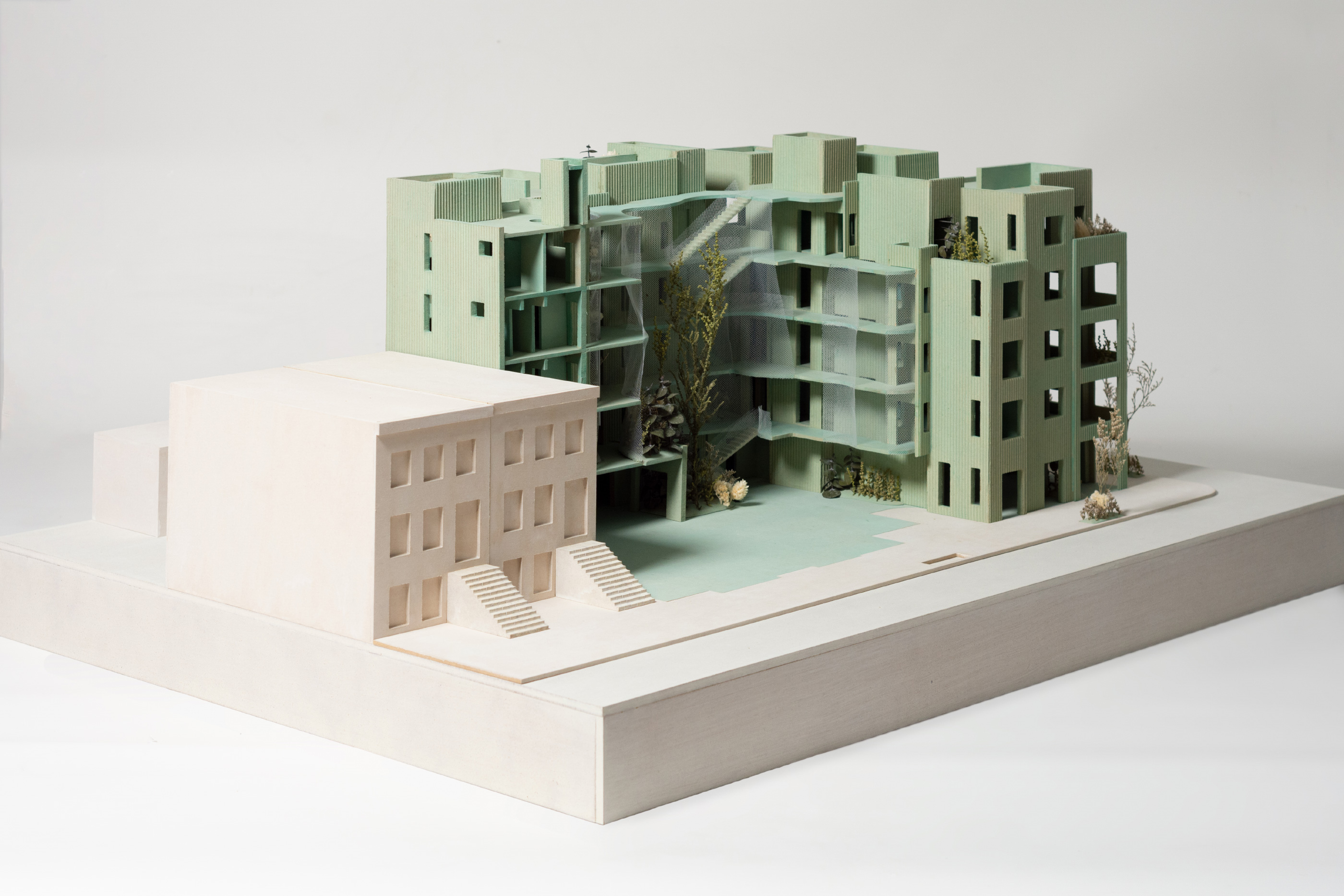 Model of an apartment building with large exposed courtyard