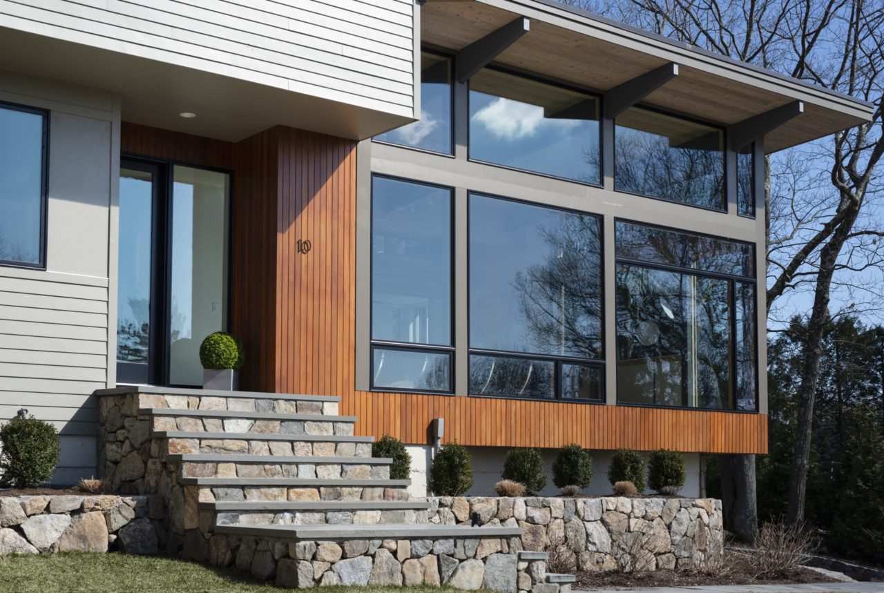 A hilltop home fronted with wood from the Acorn Deck House Company