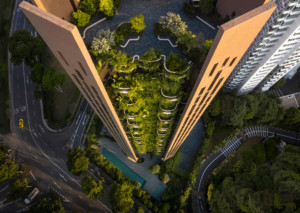 Looking down at EDEN tower in singapore, with planted balconies amid concrete slat walls