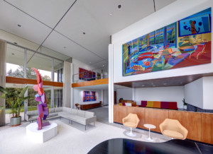 Interior of a modernist home splashed with paintings for virtual window