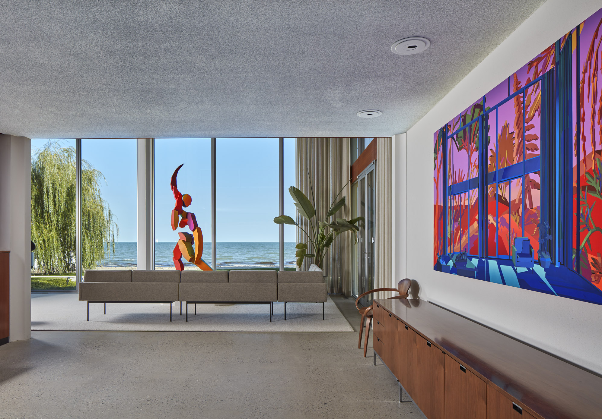 view of a lake out a window with a colorful sculpture in Virtual Window