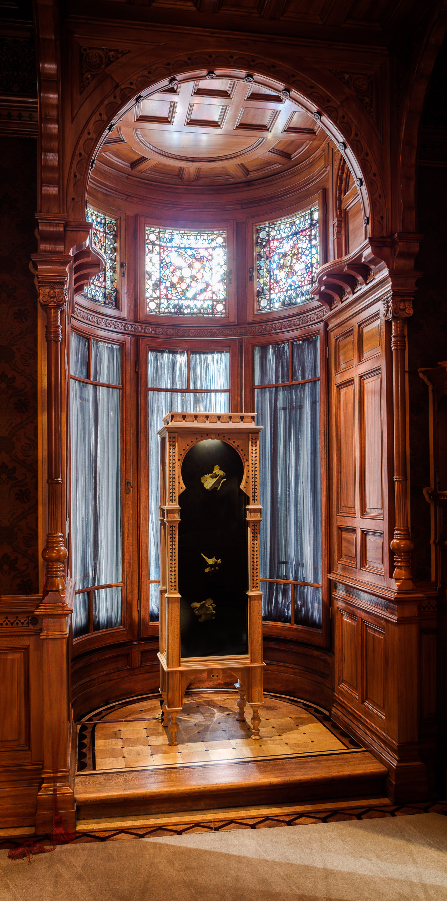 Image of a tall wooden cabinet beneath a key arch