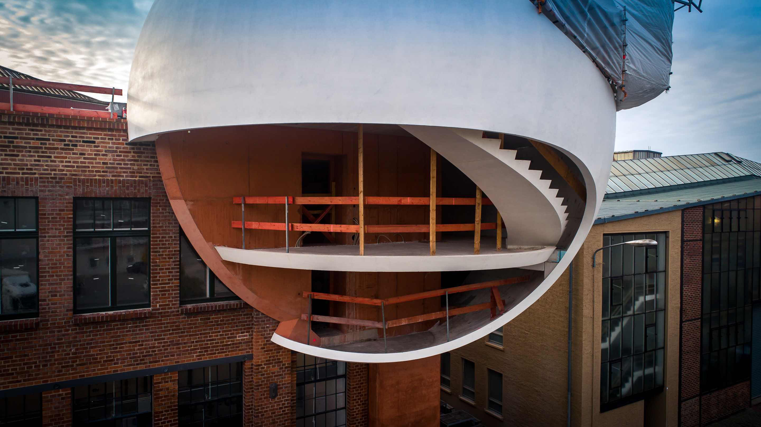a spherical addition to a building under construction