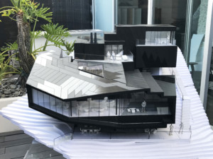 Model of a black ski lodge with rivers of windows
