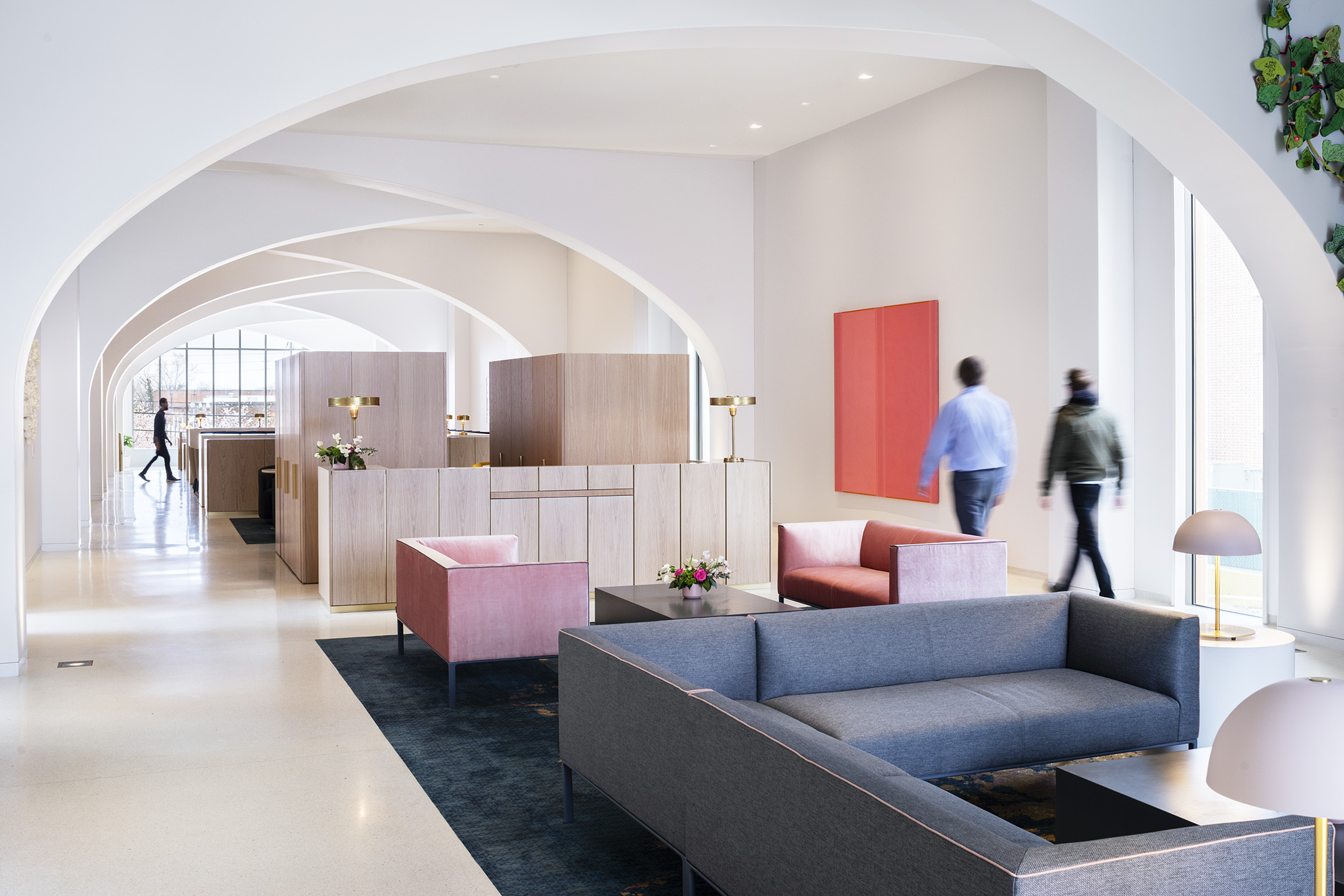 An interior white space with colorful couches
